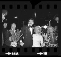 "Burt Reynolds and Dinah Shore arriving at premiere of motion picture ""The Man Who Loved Cat Dancing"" in Los Angeles, Calif., 1973"