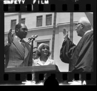 Tom Bradley, with wife Ethel, being sworn-in as mayor by Justice Earl Warren in Los Angeles, Calif., 1973