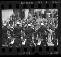 Mayor Tom Bradley on podium with LAPD motorcycle drill team lined up before him during his inauguration in Los Angeles, Calif., 1973