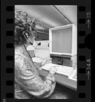 General Telephone Company operator using a computerized microfilm telephone directory in Los Angeles, Calif., 1973