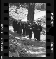 Zen Buddhist monks and students walking to lunch at Mt. Baldy Zen Center, Calif., 1973