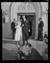 Actor Jimmy Stewart and Gloria H. McLean walking out of Brentwood Presbyterian Church after their wedding ceremony, Los Angeles, 1949