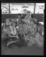 Mmes. John Caster, Robert Wyckoff, Douglas Freeman and James Keefe at Santa Monica Swimming Club luau, 1949