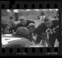 Football players in a huddle at Loyola High School in Los Angeles, Calif., 1973