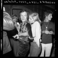 Hugh Hefner with Lenka Norakova during party at Playboy Mansion in Los Angeles, Calif., 1973