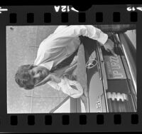 "Burt Blum displaying his recalled personalized license plate reading ""UP URZ2"" Calif., 1973"