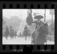 Charros riding horses in Mexican Independence Day parade in East Los Angeles, Calif., 1973