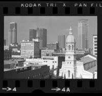 Cityscape with St. Vibiana's Cathedral and high-rise buildings in downtown Los Angeles, Calif., 1973