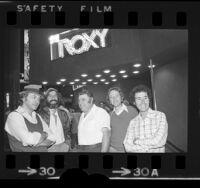 Bill Graham, Lou Adler, Chuck Landis, Elliot Roberts and David Geffen standing under the Roxy nightclub marquee in Los Angeles, Calif., 1973