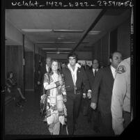 Elvis and Priscilla Presley leaving courtroom after divorce hearing in Santa Monica, Calif., 1973