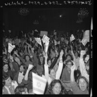 Crowd waving Israeli flags during rally at the Hollywood Palladium in Los Angeles, Calif., 1973