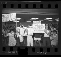 "People at Pro-Arab rally with placards reading ""Palestine Al-Fateh Revolution Until Victory"" and ""Arab Palestine For All Palestinians"" Los Angeles, Calif., 1973"