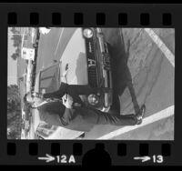 Michael Sanyour, from Subaru of America posing with original Subaru in Los Angeles, Calif., 1973