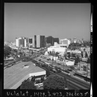 Cityscape of Beverly Hills looking east along Wilshire Blvd. at Santa Monica Blvd, Calif., 1973