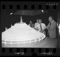 Disney imagineers examining a model of Disney World's Space Mountain, 1973