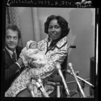 Congresswoman Yvonne Brathwaite Burke and husband William presenting newborn daughter Autumn to reporters in Los Angeles, Calif., 1973