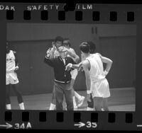 UCLA basketball coach John Wooden drilling players during practice in Los Angeles, Calif., 1973
