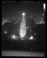 Tree lighting ceremony for 105-foot Christmas tree in Pershing Square, Los Angeles, Calif., 1949