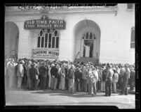 Essie Binkley West and men outside Old Time Faith Sunshine Mission in Los Angeles, Calif., 1949