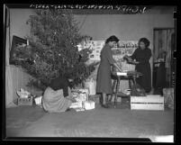 Three women preparing Christmas gifts at Los Angeles Indian Center, 1949