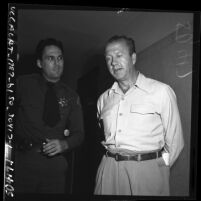 Dr. Eric Kirk and Sheriff L.L. McGillan during grand jury abortion investigation, Los Angeles, Calif., 1950
