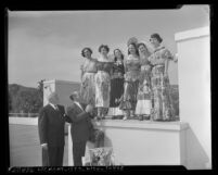 Jimmy McHugh and Russell Havenstrite judging Queen of Mexican Polo contestants at Beverly Hills Polo Club, Beverly Hills, 1950