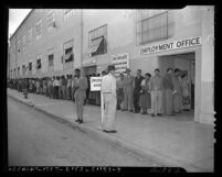 Line people waiting outside aircraft industry employment office in Los Angeles, 1950