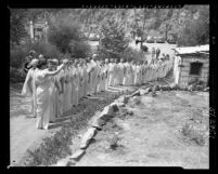 Women in togas at dedication of Golden Lotus Temple of the Self-Realization Fellowship Church in Los Angeles, Calif., 1950