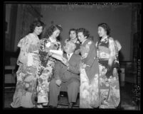 Mayor Fletcher Bowron with five contestants for Nisei Week Queen in Los Angeles, Calif., 1950