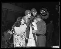California National Guardsmen kissing their wives goodbye as they depart for Camp Cooke, Calif., 1950