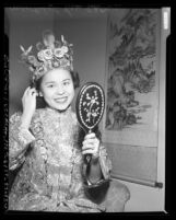 Mrs. Robert Lee dressed in traditional Chinese clothing for Chinese American fashion show, Calif., 1950