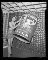 Model Stephany Hampson with display for Yenberg's All-Pure Evaporated Milk, Calif., circa 1950