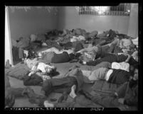 Jail cell filled with sleeping men arrested for drunkenness on Christmas Day in Los Angeles, Calif., 1950
