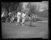 Gloria Fecht, Carmen Foster, and Golda Duncan playing golf, Calif., 1951