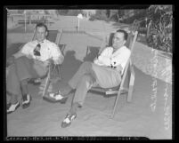 J. Edgar Hoover and his assistant Clyde Tolson sitting in beach lounge chairs, circa 1939