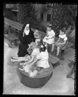 Sister Maria Luz with five girls at the Little Flower League Missionary Home in Los Angeles, Calif., 1951