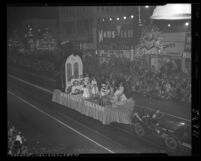 "Hollywood Christmas parade crowd watching Marymount College float ""Peace Through Prayer"" in Los Angeles, Calif., 1951"