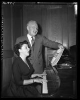 Judy Garland at piano with Los Angeles Mayor Fletcher Bowron publicity for Proclamation of Music Week, Los Angeles, 1952