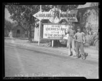 Two WPA workers hitchhiking besides Highland Springs Resort and cherry orchards billboard, Beaumont, circa 1939