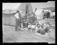 Musicians entertaining children at Farm Security Administration camp during cherry harvest, Beaumont, 1939