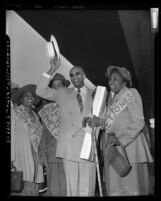 James Francis Marion Jones, (aka Prophet Divine) of Detroit with supporters at Los Angeles Union Station, Calif., 1952