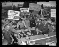 Supporters surrounding U.S. presidential candidate Adlai Ewing Stevenson, riding in automobile during campaign in Los Angeles, Calif., 1952