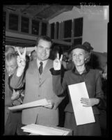 "U.S. Senator and Vice-Presidential candidate Richard M. Nixon and wife Patricia making ""V"" signs with fingers, Calif., 1952"