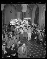 Young Republicans members waving states' delegates signs in aisle of chamber as people watch presidential election results Los Angeles, Calif., 1952