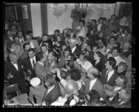 People swarming Vice-President Elect Richard M. Nixon at Republican headquarters after winning in the presidential election, Calif., 1952