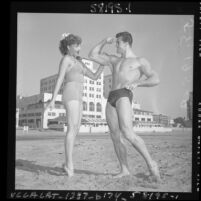Ed Holovchik [aka Ed Fury], bodybuilder and Mr. Los Angeles contestant with model Jackie Coey, 1953
