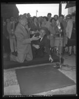 Ezio Pinza joking with Jimmy Durante as Pinza leaves his imprints at the Chinese Theater in Los Angeles, Calif., 1953