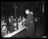 Catholics receiving blessing during Ash Wednesday service at St. Joseph's Catholic Church in Los Angeles, Calif., 1953