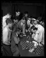 Ray Martin and Arthur Spiller, state champion chess masters playing game, as group of boys watch in Los Angeles, Calif., circa 1953