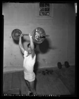Bantamweight boxer Frankie Campos lifting weights in Los Angeles, Calif., circa 1953
